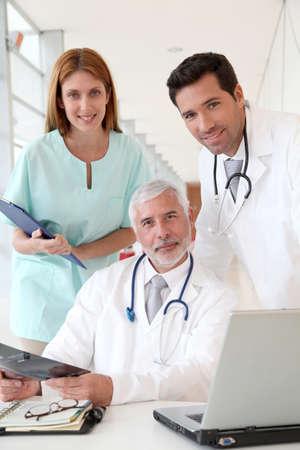 Medical team checking Xray photo
