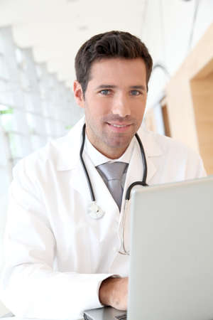 Portrait of young doctor at work photo