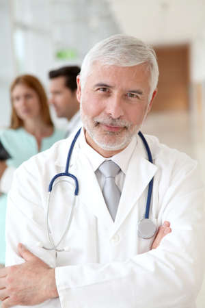 50 years old man: Portrait of smiling senior doctor  Stock Photo
