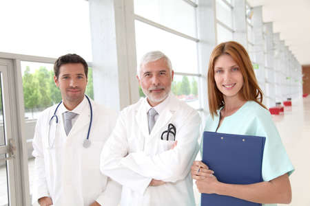 Portrait of medical team standing in hospital hall Stock Photo - 9480507