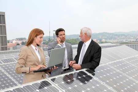 Business people meeting on photovoltaic setup photo