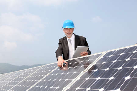 Businessman checking photovoltaic installation photo