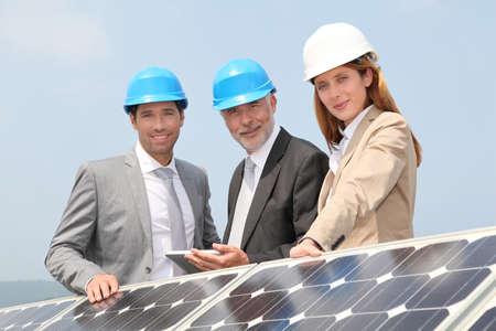 Engineers checking solar panels setup photo