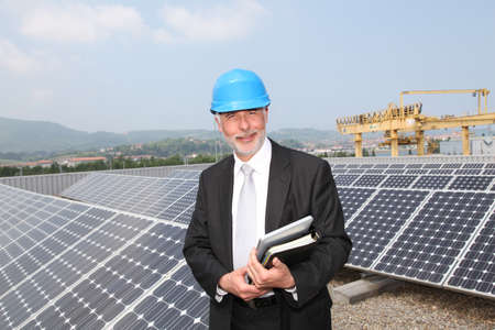 Businessman checking photovoltaic installation Stock Photo - 9480729