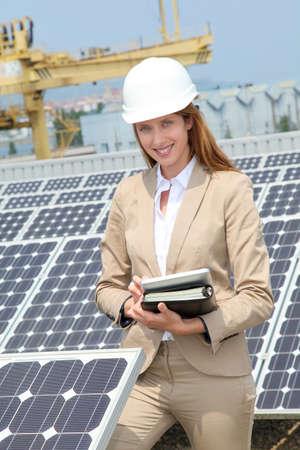 construction plant: Woman engineer checking solar panels setup