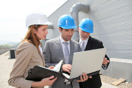 industrial worker: Business people meeting on industrial site