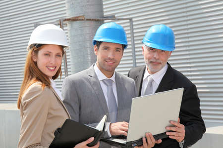 Business people meeting on industrial site photo