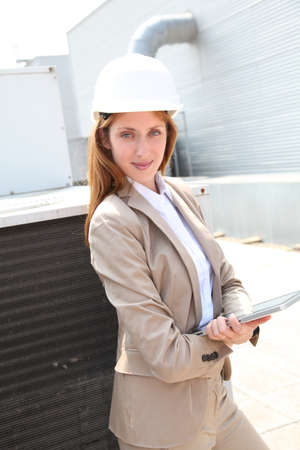 Portrait of businesswoman wearing security helmet photo