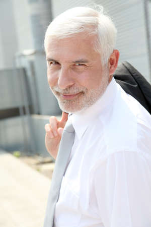 50 years old man: Portrait of senior businessman standing outdoors Stock Photo