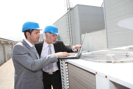 Businessmen on industrial site photo