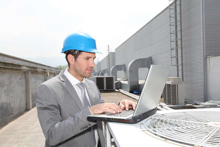 Businessman checking industrial installation photo