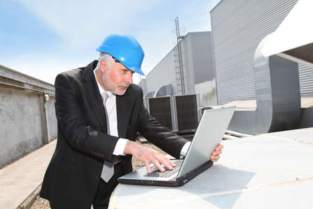 Businessman checking industrial site photo