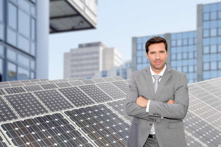 outdoor electricity: Businessman standing by photovoltaic installation