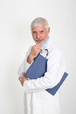 Senior doctor with hand on chin photo