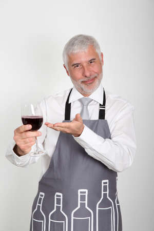 50 years old man: Wine waiter standing on white background