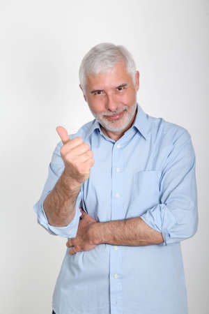 50 years old man: Portrait of smiling senior man wih thumb up Stock Photo