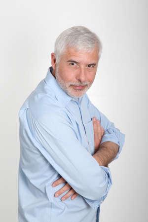50 years old man: Smiling senior man with blue shirt