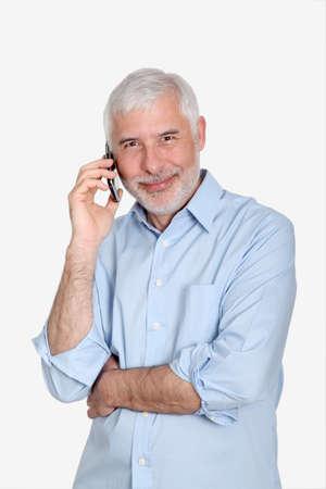Senior man using mobile phone Stock Photo - 9634608