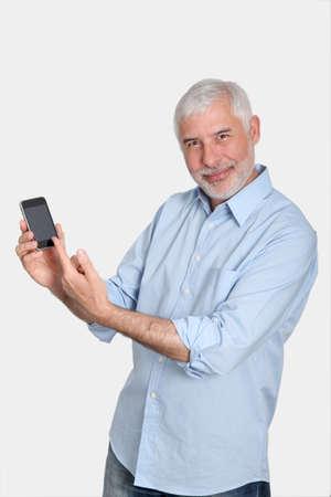 50 years old man: Senior man using mobile phone