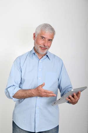 50 years old man: Senior man using electronic tablet Stock Photo