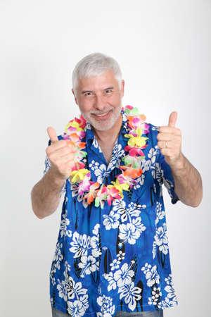 Senior man enjoying tropical vacation photo