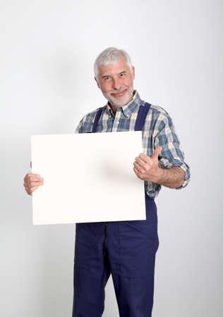 Portrait of artisan showing white board photo