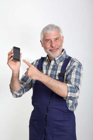 Portrait of artisan with mobile phone photo