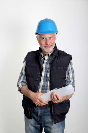 Construction site manager with security helmet photo
