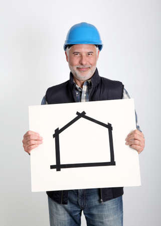Property developer showing house for sale sign photo