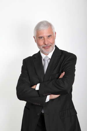Businessman standing with arms crossed photo