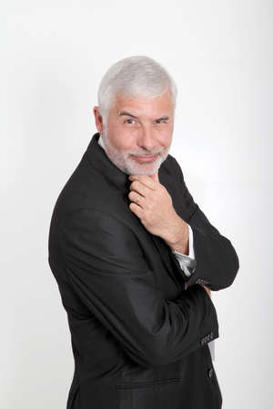 50 years old man: Portrait of businessman with hand on chin Stock Photo