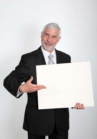 Businessman holding message board photo