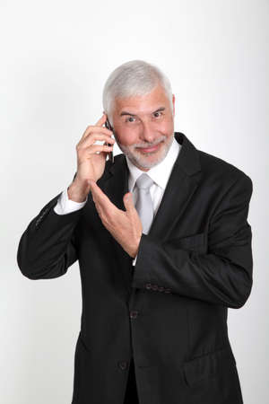 Businessman talking on mobile phone photo
