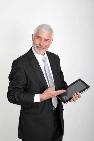 Businessman using electronic tablet photo