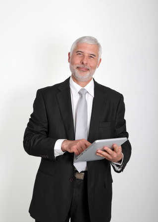 50 years old man: Businessman using electronic tablet