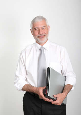 Businessman standing with laptop computer photo