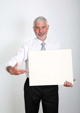 Businessman holding promotional message board photo