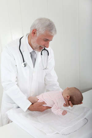 Pediatrician examining babys good health photo