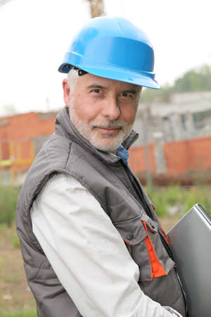 Portrait of construction manager on building site photo
