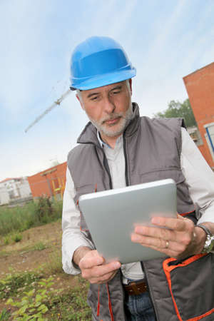 Site manager using electronic tablet photo