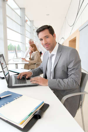 Businessman working on laptop computer photo