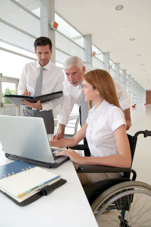paraplegic: Handicapped woman attending a meeting in office Stock Photo
