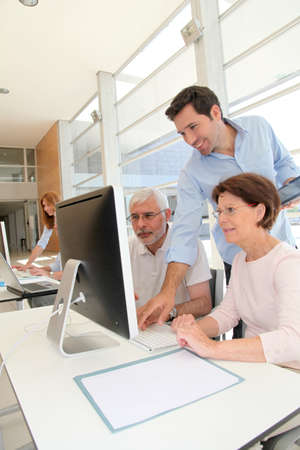 55 years old: Group of senior people in business training Stock Photo