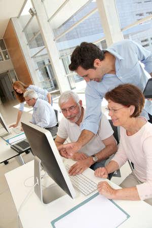 Group of senior people in business training Zdjęcie Seryjne