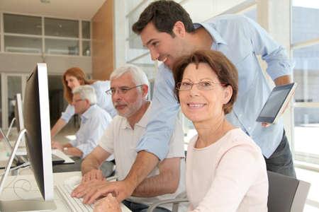 Portrait of senior woman attending computing training photo