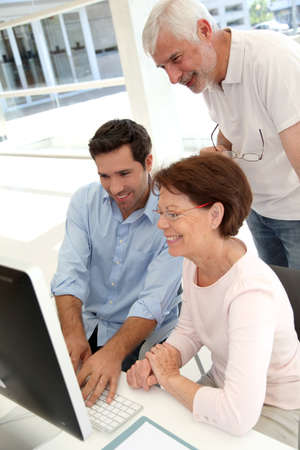 Senior people attending business training photo