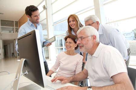 Senior people attending business training Stock Photo - 9634706