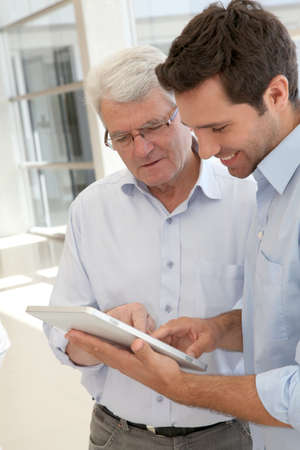 Senior man learning how to use electronic tablet Stock Photo - 9634848