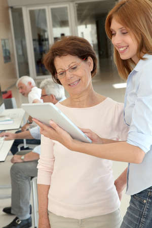 Senior woman learning how to use electronic tablet Stock Photo - 9634897
