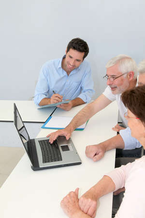 Group of senior people attending job search meeting photo
